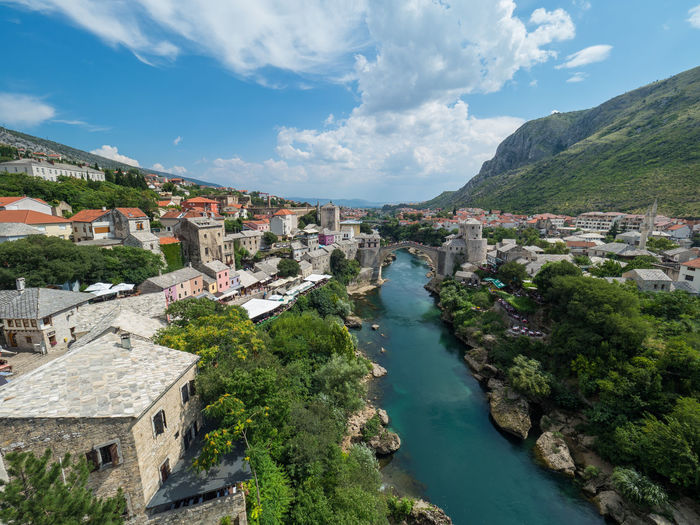 Bosnia And Herzegovina Mostar Nature Riverside Travel Photography Architecture Blue Sky Building Exterior Built Structure Cloud - Sky Day Nature No People Orage Outdoors Plant River Sky Stari Most Travel Destinations Tree Water
