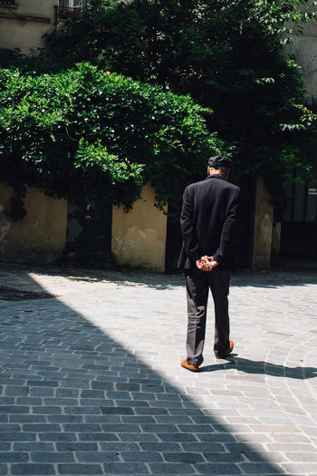 Walk until the sun goes down The Street Photographer - 2018 EyeEm Awards Clothing Day Footpath Formalwear Full Length Growth Lifestyles Males  Men Nature One Person Outdoors Plant Real People Standing Suit Sunlight Tree Well-dressed