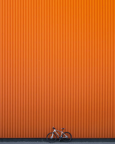Architecture Built Structure No People Day Outdoors Bicycle Transportation Land Vehicle Mode Of Transportation Orange Color Wall - Building Feature Copy Space Metal Backgrounds Wall
