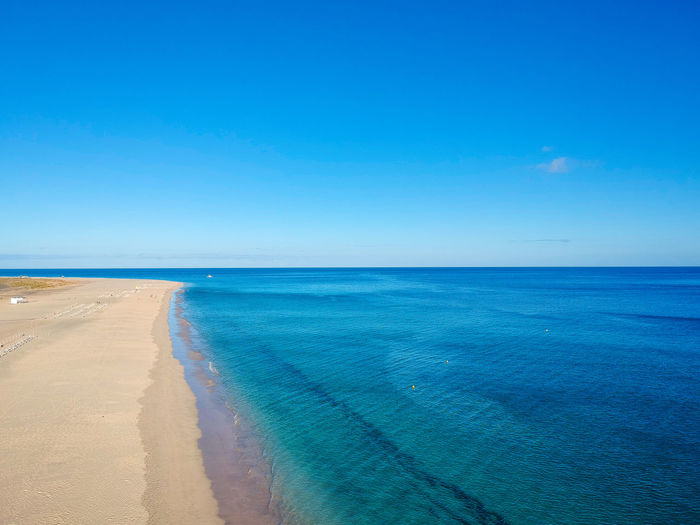Canarias Canary Islands Drone  Fuerteventura Beach Beauty In Nature Blue Canary Clear Sky Day Horizon Horizon Over Water Morro Jable Nature No People Ocean Sand Scenics - Nature Sea Sky Tranquil Scene Tranquility Turquoise Colored Water Water's Edge