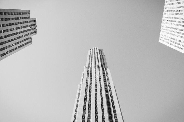 Directly below shot of buildings in city against sky