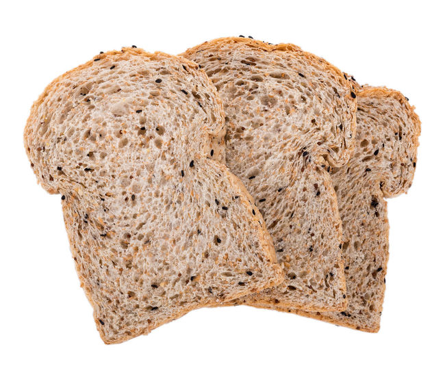 whole wheat bread isolated on white background Bread Bread Basket Breads Food Food And Drink Freshness White Background Whole Wheat Bread
