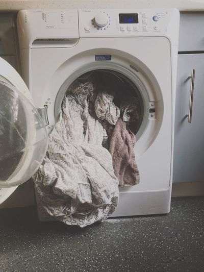 Cloths in washing machine at home