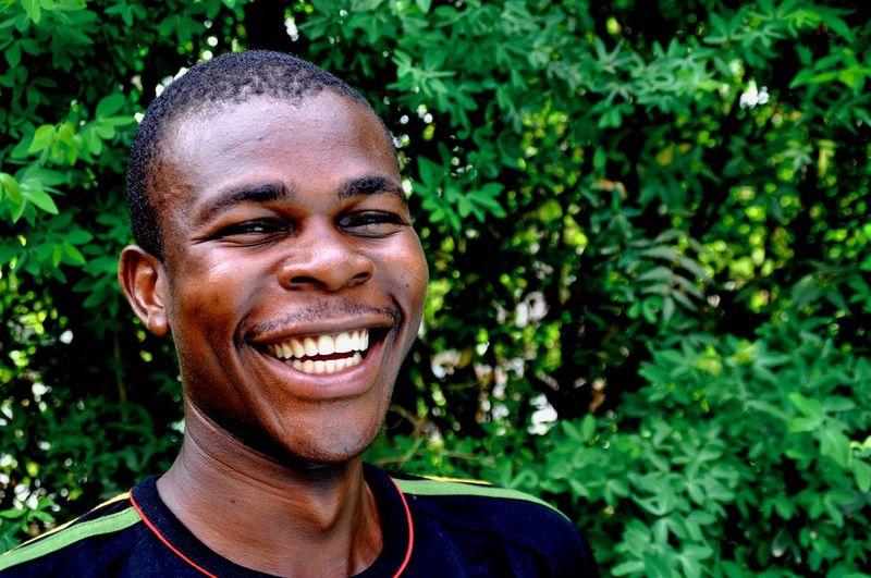 Portrait of smiling man against plants