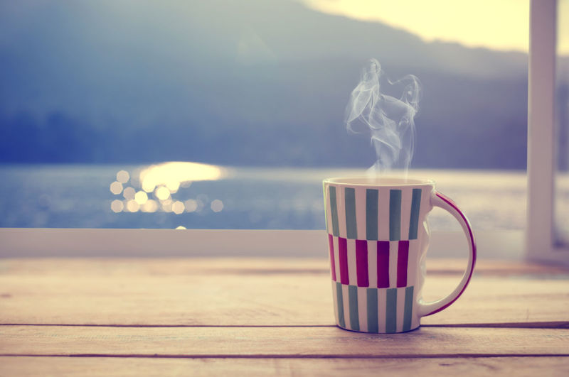 Hot coffee cup on wood table on window, summer time (vintage color tone) Table Cup Drink Mug No People Coffee Cup Day Coffee Food And Drink Nature Refreshment Coffee - Drink Outdoors Non-alcoholic Beverage Spring Summer Hot Drink Sunlight Morning Light Vintage