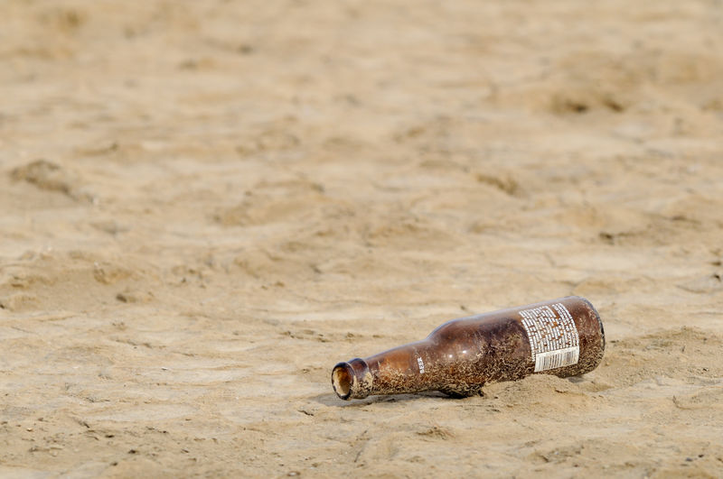 Abandoned beer bottle Beer Beer Bottle Abandoned Beach Beachphotography Bokeh Bottle Brown Clean Shot Day Dirt Drink Empty Beer Empty Beer Bottle Focus On Foreground Food And Drink Lager Litter Littering No People Polar Beer Pollution Polution Sand Single Object