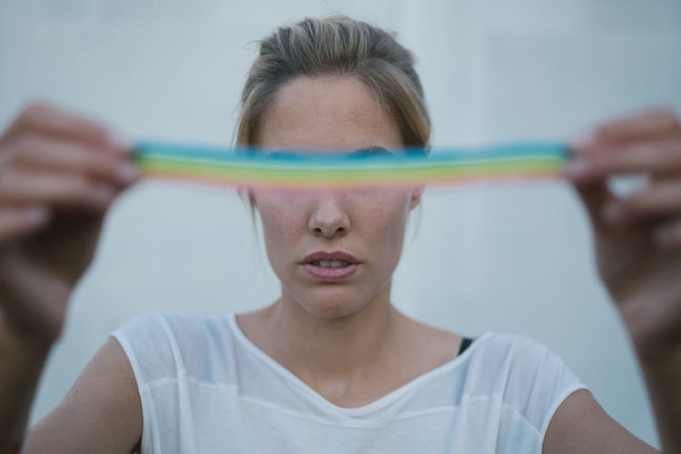Rainbow Rainbow Rainbow Colors Rainbow🌈 Women Blond Hair Blonde Girl Headshot Portrait Front View One Person Holding Focus On Foreground Close-up Lifestyles Eyes Closed  Casual Clothing Young Adult Indoors  Real People Adult Leisure Activity Human Body Part Pre-adolescent Child