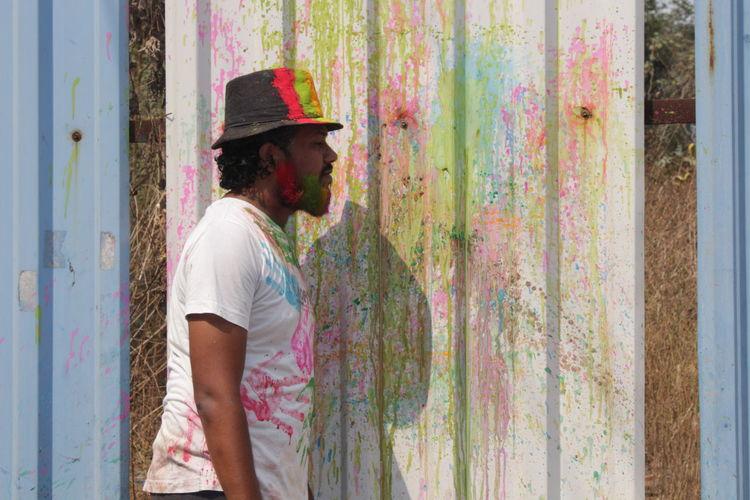 festival EyeEm Selects Holi Portrait Men Standing Multi Colored Mid Adult Mid Adult Men Environmentalist Paint Art Studio Painter - Artist Artist Powder Paint Posing Paintbrush