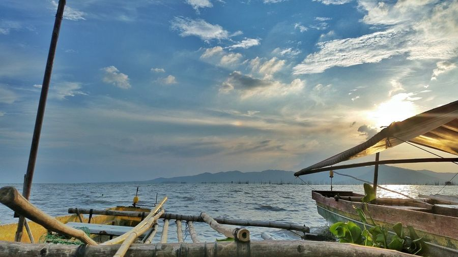 Sea Nautical Vessel Sky Water Beach Cloud - Sky Social Issues Arrival Outdoors No People Nature Beauty In Nature Day Jalajala Rizal Philippines Philippines Talim Island Mountain Boat