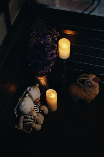 High angle view of burning candles on table