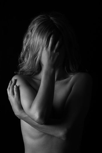 Studio Shot One Person Hand Black Background Indoors  Emotion Human Hand Sadness Women Emotional Stress Covering Adult Depression - Sadness Portrait Obscured Face Young Adult Human Body Part Front View Unrecognizable Person Hairstyle Embarrassment