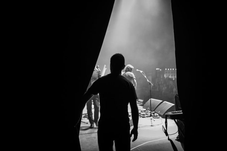 Rear View Of Silhouette Man Standing On Stage