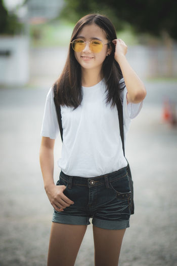 Cheerful young woman standing outdoors