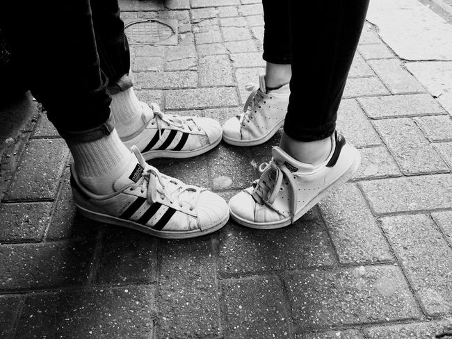 Young love Couple Adidas Love The Street Photographer - 2016 EyeEm Awards The Portraitist - 2016 EyeEm Awards The Photojournalist - 2016 EyeEm Awards Street Photography Shoes Youth Culture Youth Group Youth Of Today Young Love Check This Out Blackandwhite Black & White Blackandwhite Photography Black&white Blackwhite First Kiss Kiss Beautiful Capture The Moment Untold Stories Silent Moment