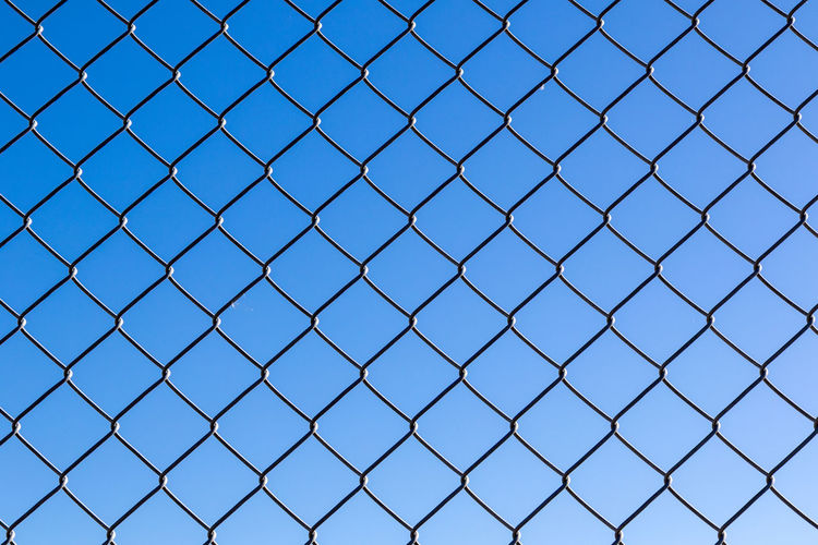 Chainlink Fence Against Clear Blue Sky