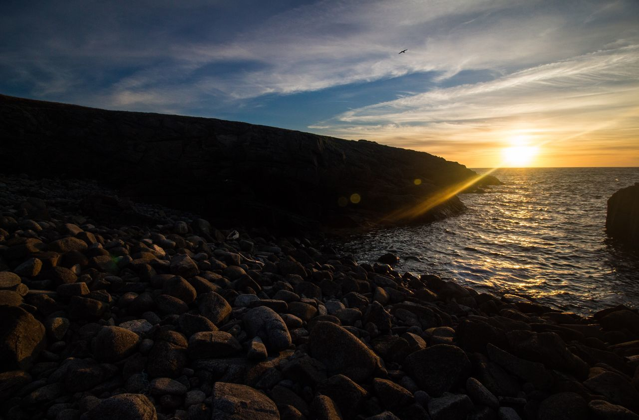 sky, water, rock, scenics - nature, beauty in nature, cloud - sky, solid, sunset, sea, rock - object, tranquil scene, tranquility, nature, beach, land, mountain, non-urban scene, idyllic, stone - object, no people, pebble, outdoors