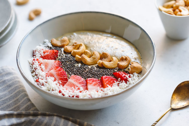 Food And Drink Food Freshness Healthy Eating Bowl Wellbeing Indoors  Fruit Table Ready-to-eat No People Close-up Focus On Foreground Still Life Berry Fruit Kitchen Utensil Spoon Breakfast Indulgence Sweet Food Porridge Yogurt Temptation