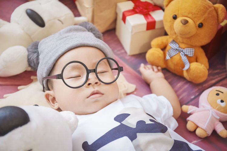 Childhood Eyeglasses  Child Toy Glasses Indoors  Stuffed Toy Headshot Representation Cute Portrait Boys Innocence Teddy Bear Real People Lying Down Relaxation Males  Lifestyles