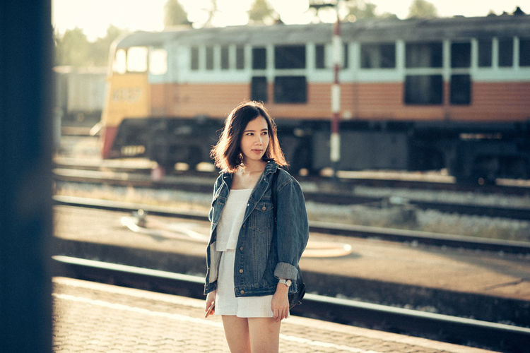 Beautiful Woman Built_Structure Casual Clothing Day Lifestyles One Person Outdoors People Public Transportation Rail Transportation Railroad Station Railroad Station Platform Railroad Track Real People Standing Train - Vehicle Transportation Waiting Young Adult Young Women Fresh On Market 2018