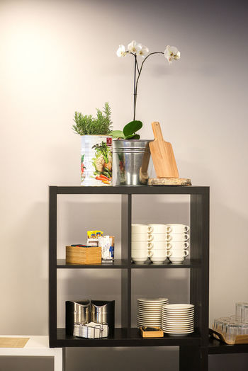 Black rack with kitchen utensils against wall