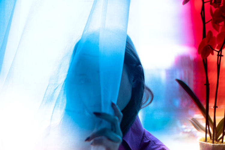 Close-up of man holding blue window