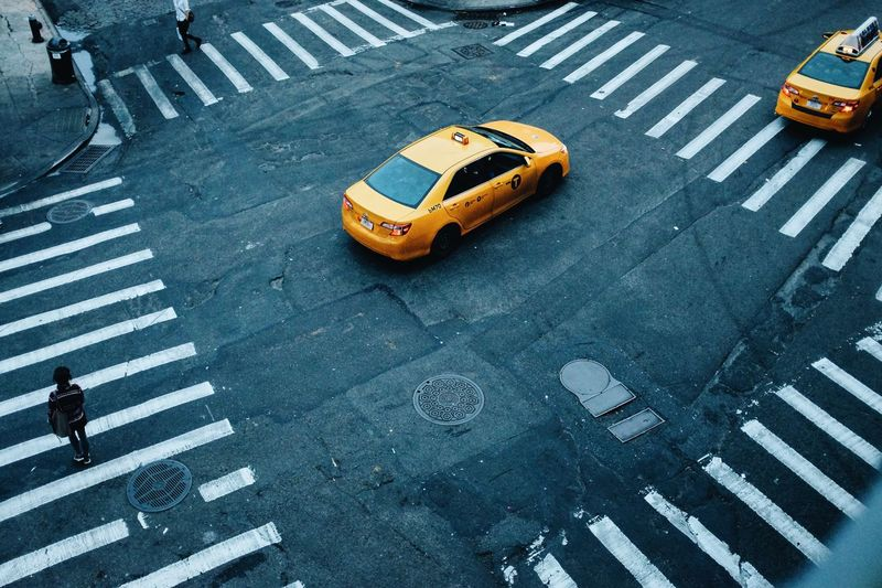 High angle view of yellow cabs on street in nyc