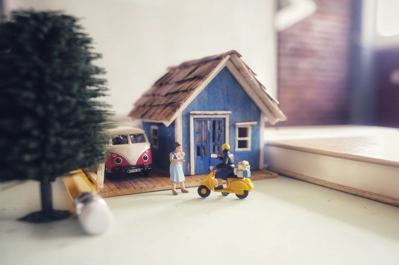 Close-up of toy car outside house against building