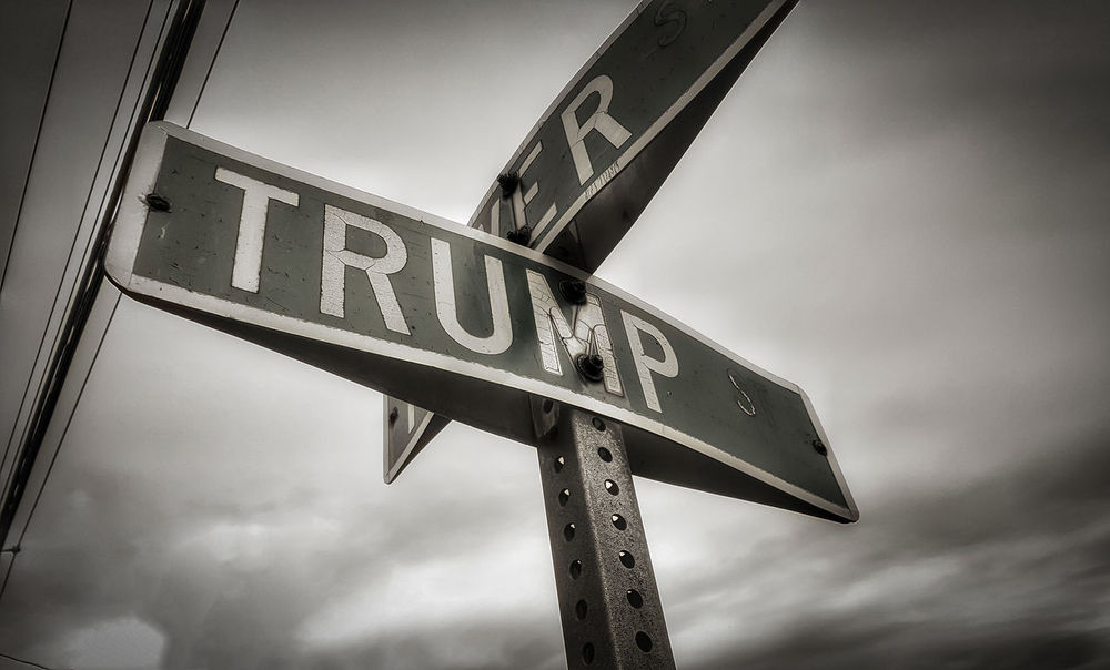On the corner of Trump and power st. Communication eBusiness Finance And Industry Road Sign Low Angle View Streetphotography Street Sign President Trump Ironic  Hilarious Depressing Eye4photography  Hello World Check This Out Samsungphotography Klique Klique Blackandwhite Shades Of Winter