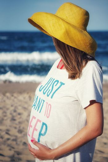 Yellow Pregnant Woman Pregnant Phtography Pregnant Beauty Pregnancy Photography Beautiful Woman People Portrait Sea Beach Women Young Women Water Standing Sand Communication Sky Pregnant Belly Abdomen New Life Hope Beginnings Hands On Stomach Maternity Wear Prenatal Care Human Fertility Calm Ocean Posing