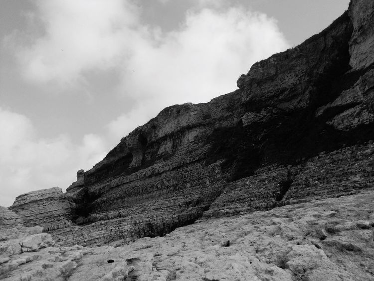 Nature Rock - Object Rock Formation Sky Low Angle View Mountain Beauty In Nature Cloud - Sky Geology Day Tranquility Physical Geography Scenics Outdoors Tranquil Scene No People Cliff Landscape Climbing