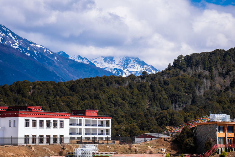 Mountain Sky Architecture Building Exterior Built Structure Beauty In Nature Scenics - Nature Building Cloud - Sky Mountain Range Nature No People Day Snow Tree Winter Plant Residential District Cold Temperature Snowcapped Mountain Outdoors Mountain Peak Meili DeQin Yunnan China Tibet Fog Cold Cool