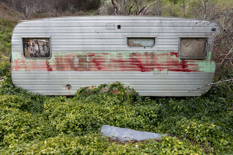 Abandoned Caravan Corrugated Iron Grass Growth No People Outdoors Plant