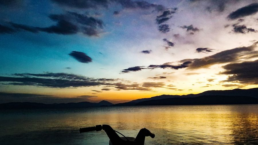 sunset over lake prespa macedonia Golden Hour Moon Tranquility Peace Motorcycle Silhouette Lake Prespa Macedonia Ohrid Lake Balkans Europe Water Sunset Silhouette Reflection Sky Cloud - Sky Calm Lakeside Low Section Dramatic Sky Standing Water