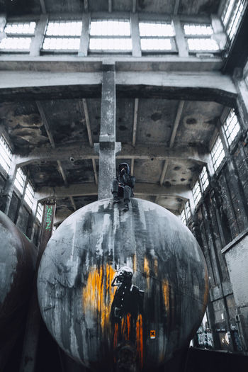 Architecture Indoors  Day Built Structure Metal Building Factory Run-down History Obsolete Abandoned No People Urban Urban Exploration Graffiti Colors Orange Color EyeEm Exploring Berlin Light And Shadow Industrial Adventure One Person Low Angle View