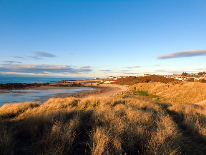Scenic view of lossiemouth beach and sea against sky