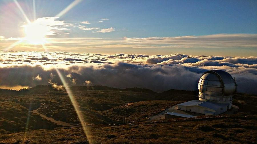 Scenic View Of Roque De Los Muchachos Observatory On Mountain By Clouds Against Sky