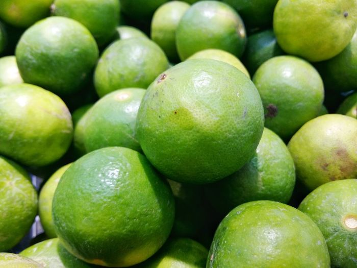 Backgrounds Citrus Fruit Close-up Food Food And Drink For Sale Freshness Fruit Full Frame Green Color Healthy Eating Market Market Stall Retail  Ripe มะนาว