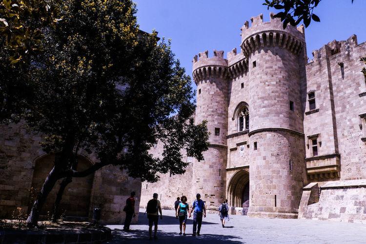 People walking in front of castle
