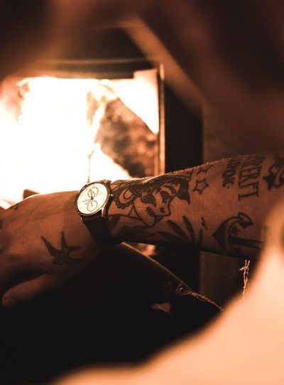 Timeless Honepage Visit Vidit Advert Canon Adobe Dobe Nature Bonfire Fire Watch Clock Indoors  Human Hand One Person Close-up Real People Human Body Part Young Adult Clock People Day