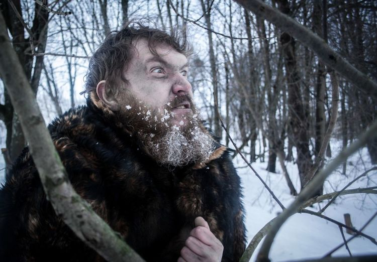 Angry man in forest during winter
