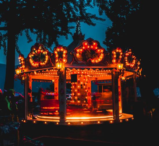 Illuminated lantern at night