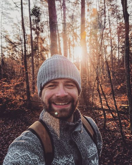 Portrait Of Smiling Man In Forest