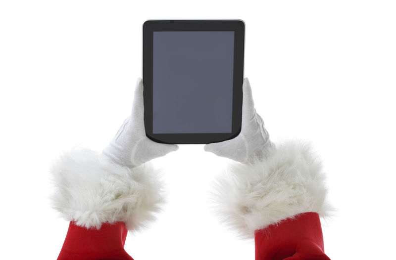 Close-up of hand holding smart phone over white background