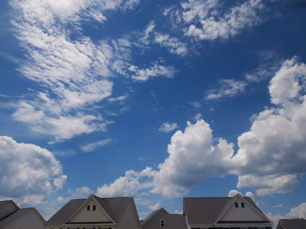 Puffy clouds are the best kind of clouds Cloud - Sky Sky Low Angle View Blue Sky Outdoors Nature Day Roof Beauty In Nature Canon_photos Canonphotography House