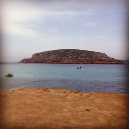 Random Holidaysnap Holiday2012 Holiday 2012 island cliff edge cliffedge sea water speedboat boat ? rock ibiza ibizaisland igers instapic instacapture instapicture pic picoftheday hefefilter sand clouds blue sky lovelyday