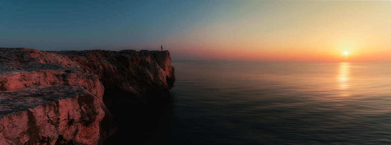 Beach Beauty In Nature Cliff Horizon Horizon Over Water Idyllic Nature No People Non-urban Scene Outdoors Rock Rock - Object Rock Formation Scenics - Nature Sea Sky Sun Sunset Tranquil Scene Tranquility Water