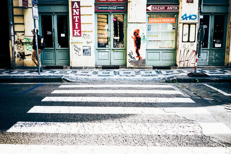Antik Architecture Built Structure City Coca Cola Sign Crossing Day Outdoors Prague Street Streetart Streetphotography Xing Zebra Colours Zebra Crossing