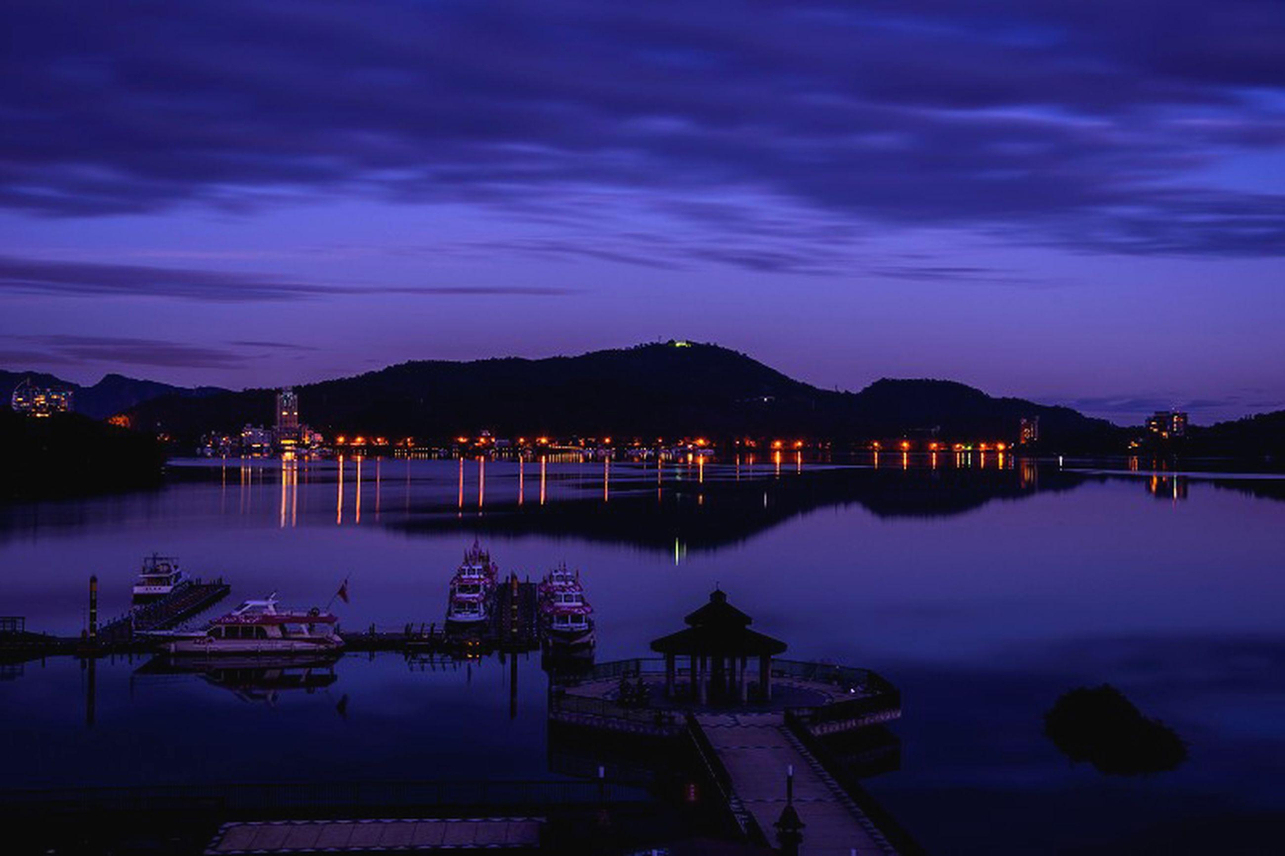 water, sky, reflection, illuminated, nautical vessel, cloud - sky, lake, mountain, moored, dusk, boat, tranquil scene, scenics, sunset, tranquility, waterfront, transportation, sea, cloud, night