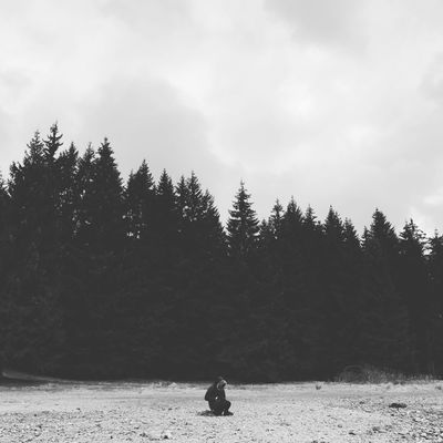 Tree Nature Sky Day Tranquility Outdoors Beauty In Nature Landscape One Person Real People Scenics Sitting Mountain People Water Nature Cold Cold Temperature Cold Weather Winter Travel
