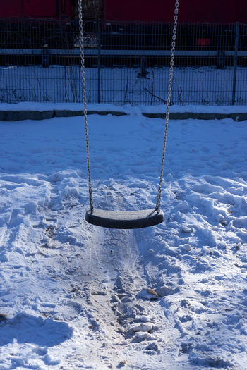 View of swing in snow